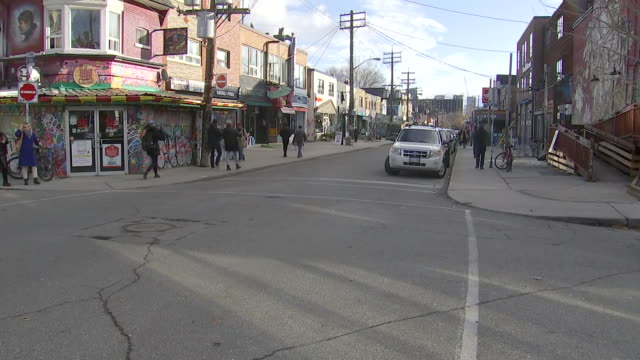 establishing shot of intersection in kensington market. - music or celebrities or fashion or film industry or film premiere or youth culture or novelty item or vacations stock videos & royalty-free footage