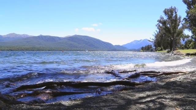 establishing shot of lake wakatipu in queenstown - flowing water stock videos & royalty-free footage