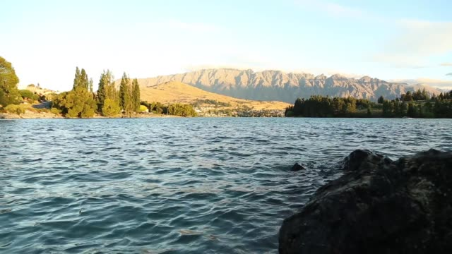 establishing shot of lake wakatipu in queenstown - evergreen stock videos & royalty-free footage