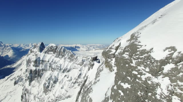 Establishing Shot of Mountain Peaks in winter Landscape with beautiful weather