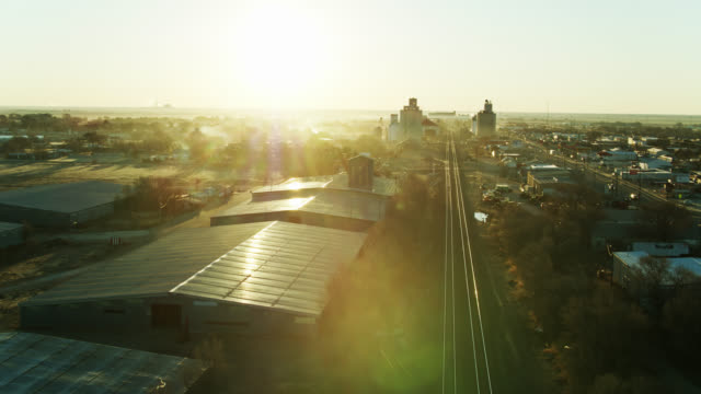 establishing shot of muleshoe, texas with dramatic lens flare - texas stock videos & royalty-free footage
