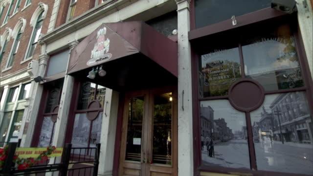 establishing shot of ned peppers bar in the oregon historic district of dayton, ohio. - dayton ohio stock videos & royalty-free footage