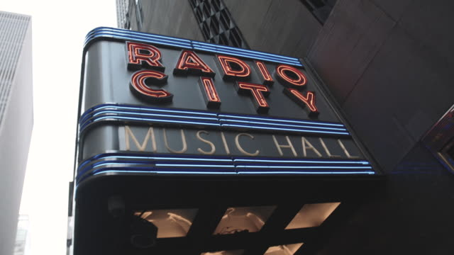 establishing shot of new york city's radio city hall marquee - radio city music hall stock videos and b-roll footage