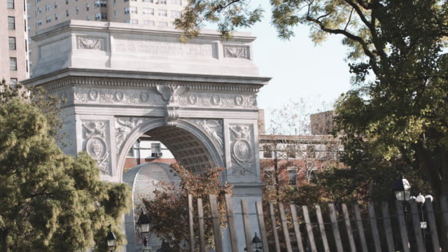 Establishing shot of New York City's Washington Square Park on a crisp Autumn morning.
