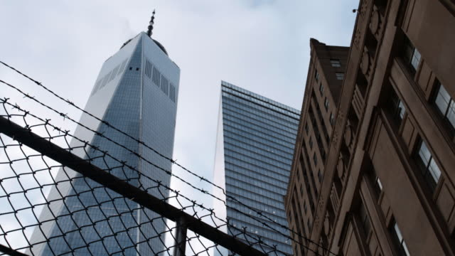 Establishing shot of NYC's World Trade Center on a cloudy afternoon.