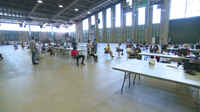 establishing shot of people at an unemployment job fair in tulsa, oklahoma during the coronavirus pandemic. - business or economy or employment and labor or financial market or finance or agriculture stock videos & royalty-free footage
