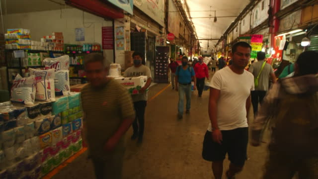 establishing shot of people walking at mexico city food market during the coronavirus pandemic - healthcare and medicine or illness or food and drink or fitness or exercise or wellbeing stock videos & royalty-free footage