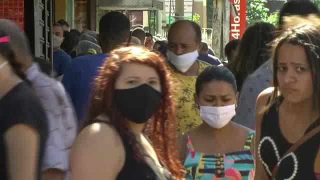 establishing shot of people walking through rio de janeiro, brazil during the coronavirus pandemic. - latin america stock videos & royalty-free footage