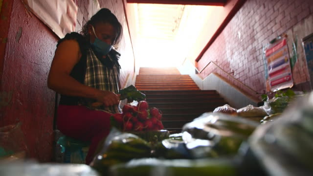 establishing shot of person cutting a cactus at mexico city food market during the coronavirus pandemic. - healthcare and medicine or illness or food and drink or fitness or exercise or wellbeing stock videos & royalty-free footage