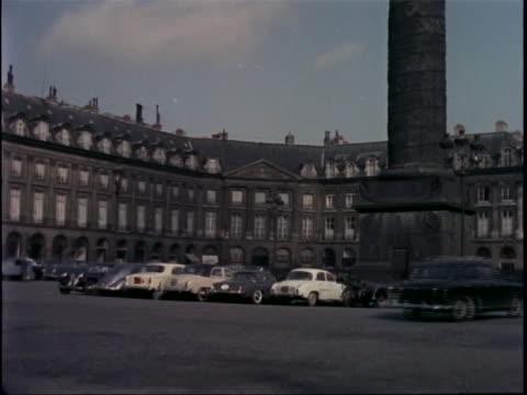 vídeos de stock e filmes b-roll de establishing shot of place vendome with cars in paris france 1960s - praça vendome