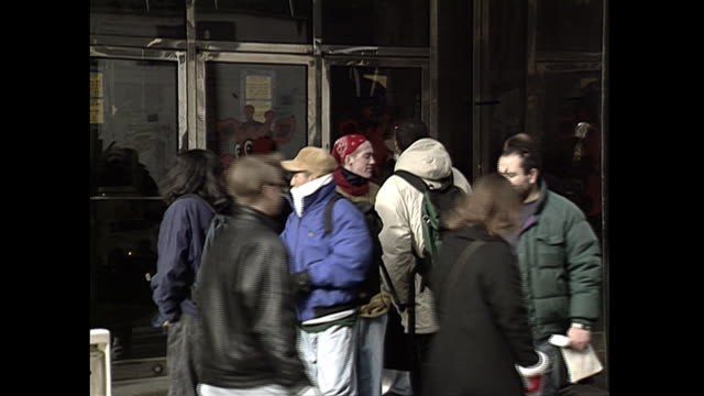 establishing shot of shoppers outside of a toys r us retail store near herald square in new york city. - toys r us stock videos & royalty-free footage