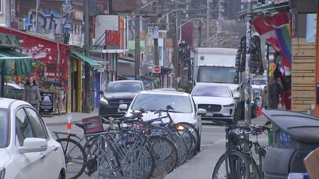 establishing shot of street in kensington market. - music or celebrities or fashion or film industry or film premiere or youth culture or novelty item or vacations stock videos & royalty-free footage