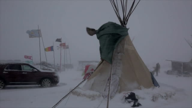 establishing shot of tents in the standing rock indian reservation in the snow - north american tribal culture stock videos & royalty-free footage