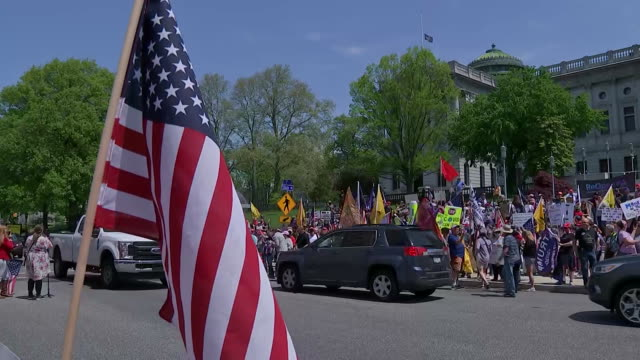 establishing shot of the american flag and a group of protesters outside of the capitol building in harrisburg, pennsylvania gathered to support... - human rights or social issues or immigration or employment and labor or protest or riot or lgbtqi rights or women's rights stock videos & royalty-free footage