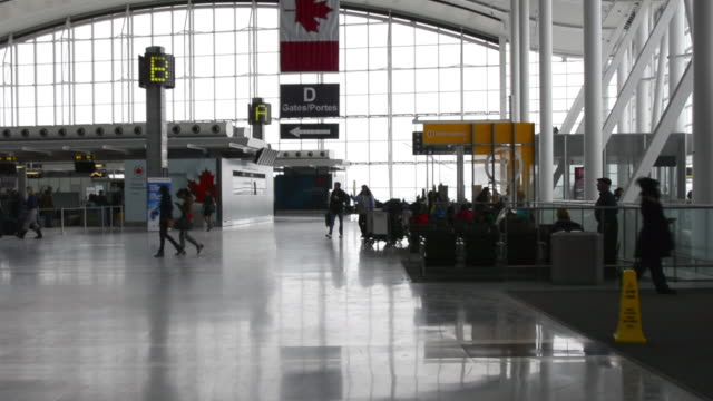 establishing shot of the departure hall the landmark is the primary international airport serving toronto and the surrounding areas it is the largest... - toronto stock videos & royalty-free footage