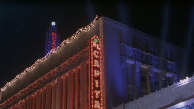 establishing shot of the el capitan theater and flashing neon sign at night. - el capitan theatre stock videos and b-roll footage