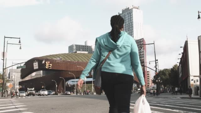 establishing shot of the entrance to Brooklyn's Barclays Center - 4k