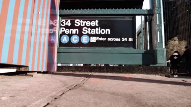 establishing shot of the entrance to penn station's subway - new york city penn station stock videos & royalty-free footage