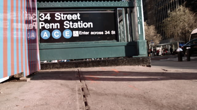 establishing shot of the entrance to the penn station subway station in new york city - new york city penn station stock videos and b-roll footage