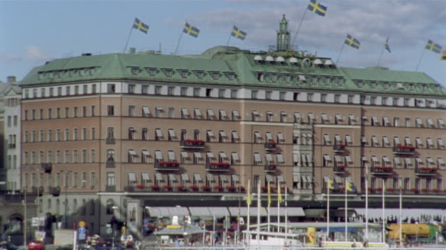establishing shot of the grand hotel / stockholm, sweden - famous place stock videos & royalty-free footage