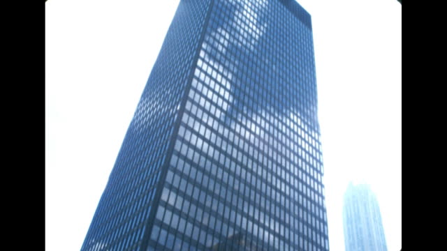 establishing shot of the seagram building in new york city in the 1960s. - building exterior stock videos & royalty-free footage