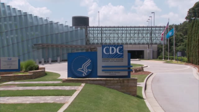 establishing shot of the sign outside the cdc headquarters in atlanta, georgia. - headquarters stock videos & royalty-free footage