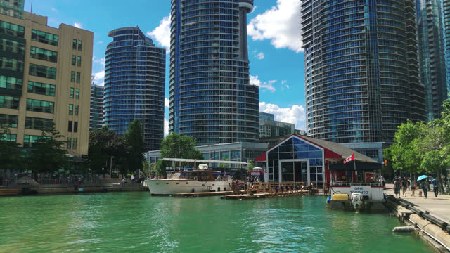 establishing shot of the waterfront district by lake ontario on july 29, 2017; in toronto, ontario, canada. the waterfront by lake ontario in the... - water surface stock videos & royalty-free footage