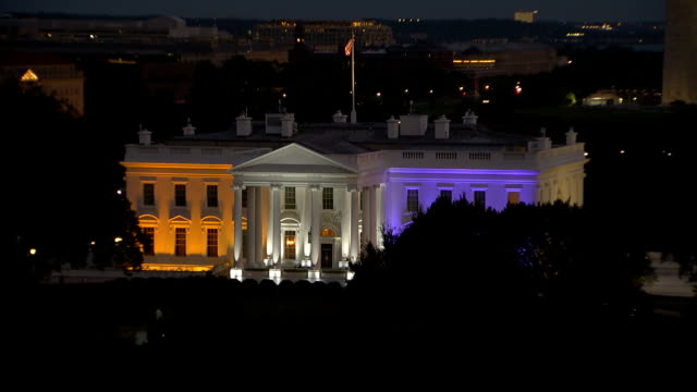 establishing shot of the white house lit up with purple and gold lights for women's suffrage. - human rights or social issues or immigration or employment and labor or protest or riot or lgbtqi rights or women's rights stock videos & royalty-free footage