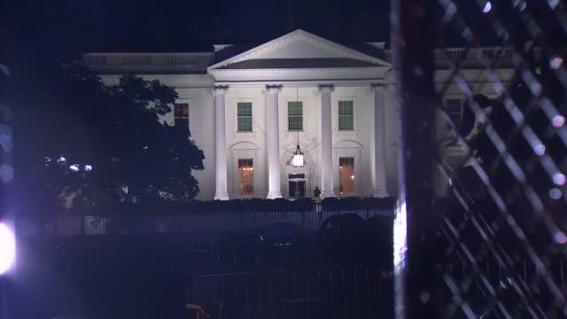establishing shot of the white house through fencing setup in lafayette square in washington dc - lafayette square washington dc stock videos & royalty-free footage