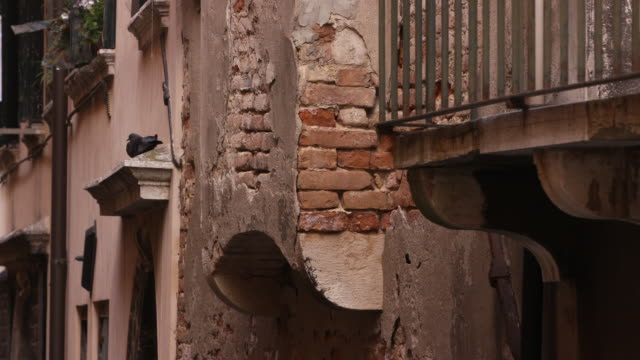 establishing shot of weathered and crumbling bricks on a building in venice, italy on september 2, 2018. - scratched stock videos & royalty-free footage