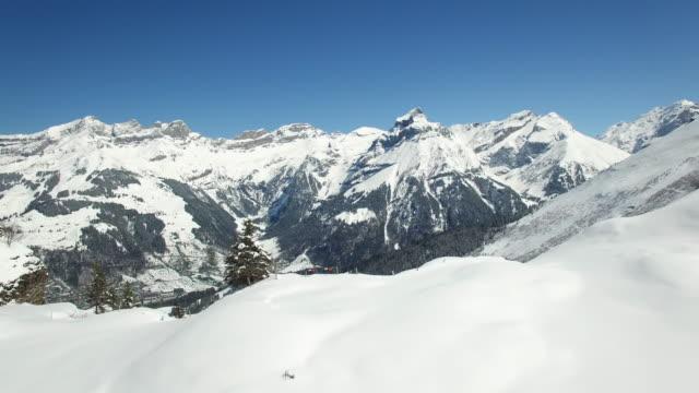 Establishing Shot of Winter Vacation Travel Destination for Skiing and Snowboarding