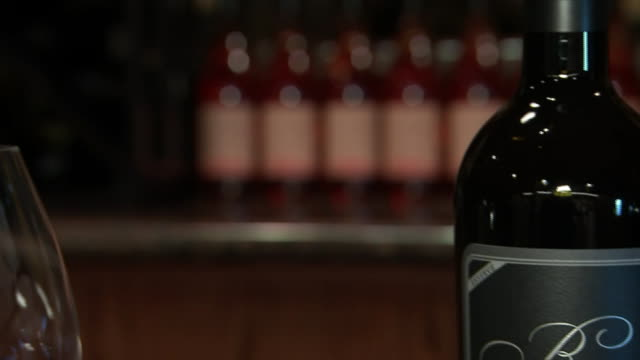 vídeos de stock, filmes e b-roll de establishing shot panning left of burgess cellars wine bottles - healthcare and medicine or illness or food and drink or fitness or exercise or wellbeing