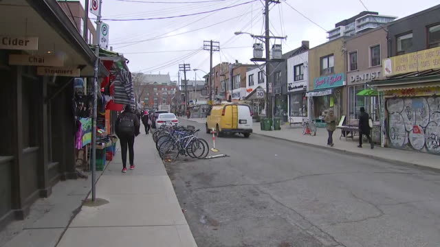 establishing shot panning left of graffiti and street in kensington market. - music or celebrities or fashion or film industry or film premiere or youth culture or novelty item or vacations stock videos & royalty-free footage