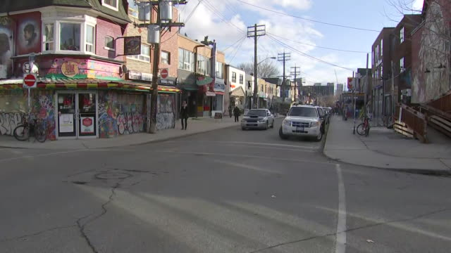 establishing shot panning right of intersection in kensington market. - music or celebrities or fashion or film industry or film premiere or youth culture or novelty item or vacations stock videos & royalty-free footage