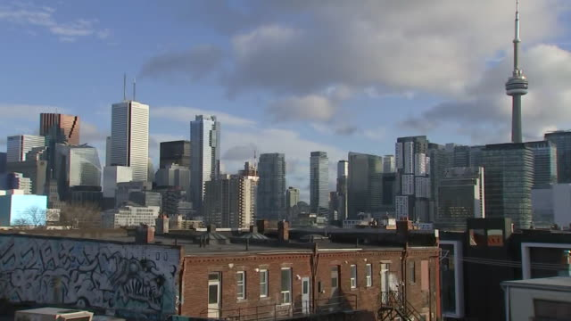 establishing shot panning right of toronto skyline from kensington market. - music or celebrities or fashion or film industry or film premiere or youth culture or novelty item or vacations stock videos & royalty-free footage
