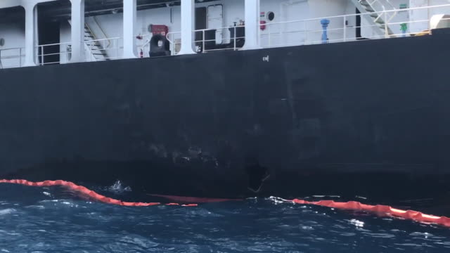 establishing shot showing a large hole on the side of an oil tanker in the gulf of oman. - tanker stock videos & royalty-free footage