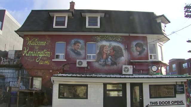 establishing shot tilting up from cracks in street to graffiti mural welcome sign in kensington market. - music or celebrities or fashion or film industry or film premiere or youth culture or novelty item or vacations stock videos & royalty-free footage