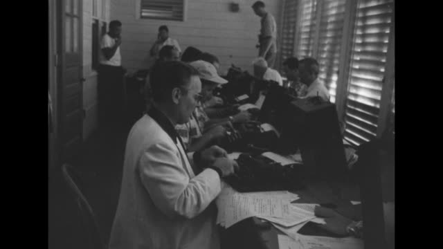 establishing shots of reporters on typewriters at president truman's vacation home in key west, florida. - 1949 stock videos & royalty-free footage