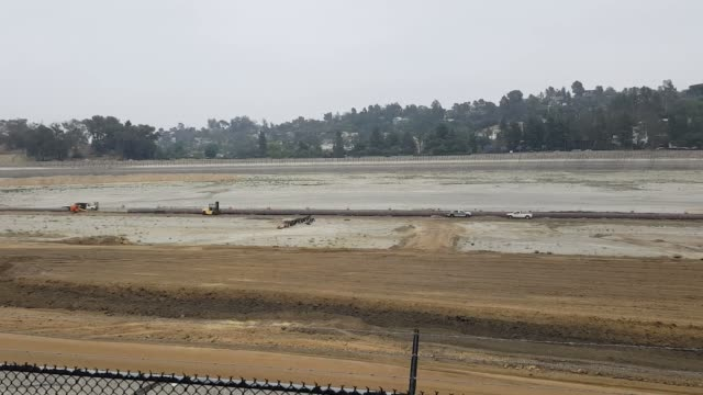 Establishing shots of the construction at the Silver lake reservoir