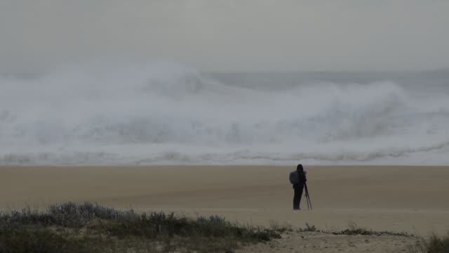 Establishing shots of the XXL waves at the Praia do Norte at Nazare Portugal