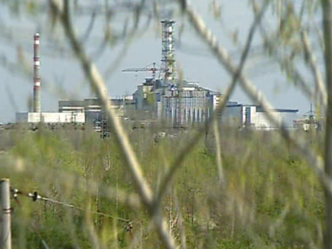 Establising shot of sarcophagus covering destroyed reactor of Chernobyl Nuclear Plant