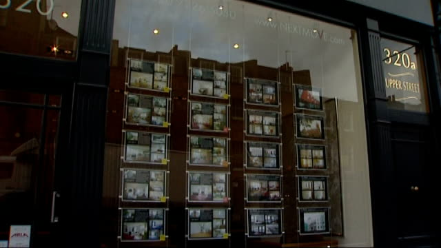 london islington ext various shots of carlton estate agent's window displaying houses properties for sale/ general views of next move estate agent's... - for sale englischer satz stock-videos und b-roll-filmmaterial