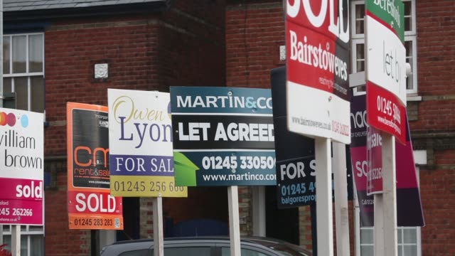 estate agents boards including 'to let' and 'for sale' stand outside residential properties in romford uk on friday march 11 2016 - for sale stock videos & royalty-free footage