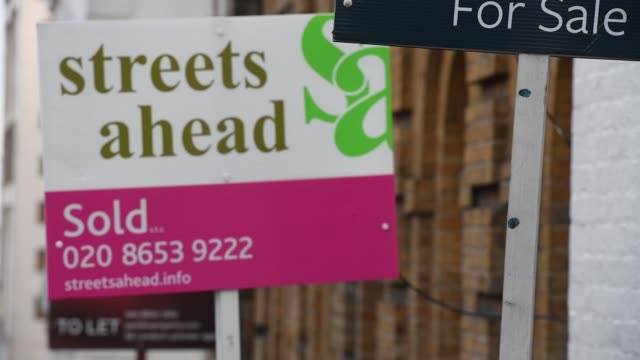 estate agents 'sold' and 'for sale' boards stand outside residential properties in london uk on thursday nov 16 photographer chris j... - for sale englischer satz stock-videos und b-roll-filmmaterial
