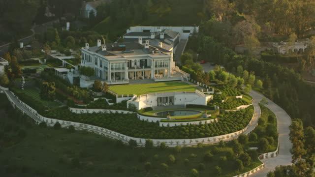 aerial estate on a hilltop in los angeles, ca - villa stock videos & royalty-free footage