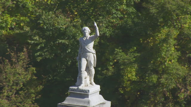 ms ha pov ethan allen statue in greenmount cemetery with tree area / burlington, vermont, united states - vermont stock videos & royalty-free footage