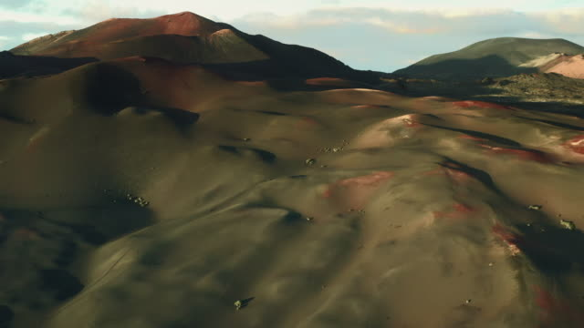 ethereal aerial views of a volcanic landscape, lanzarote, spain - natürliches muster stock-videos und b-roll-filmmaterial