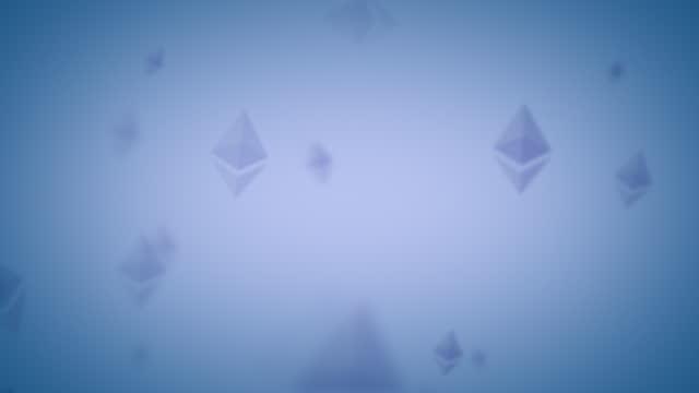 ethereum eth nft spinning logo icon looping background indigo blue on subtle blue background - loopable moving image stock videos & royalty-free footage