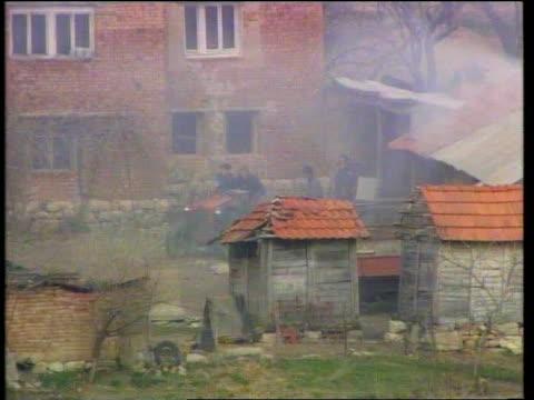 ethic albanian massacre report findings itn burning haystacks in deserted village tlms serbs pushing tractor away serbs coming out of deserted house... - haystack stock videos & royalty-free footage