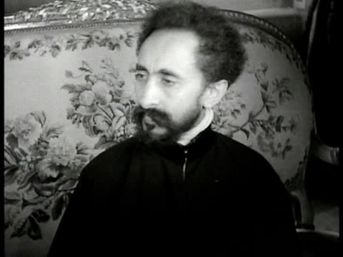 Ethiopia Emperor Haile Selassie sitting in chair Ethiopian Lion of Judah statue
